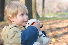 The child embraces a toy. Child embraces a toy and looks afar Royalty Free Stock Photo