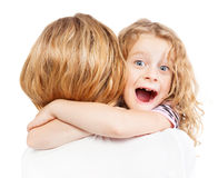 Child embracing her mother Stock Images