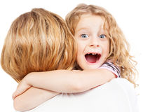 Child embracing mother Stock Image