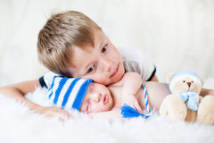 Child embracing at newborn baby brother royalty free stock photos