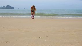 Girl in Ukrainian Costume Embroidery on Beach. Child in embroidery on the beach with mother on the background of the islands stock video footage