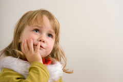 Child emotions. Young cute girl looking upward Stock Photo