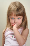 Child emotions. Young pretty girl pensive looking to You Stock Photography