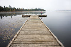 Child on end of the dock. Stock Photography