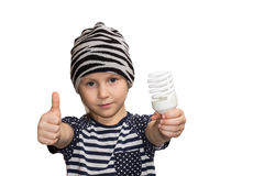 Child with energy saving lamp. Child praise energy saving lamps, which holds in his hand outstretched isolated on white background Stock Photos