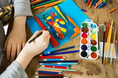 Child is engaged in creativity Stock Images