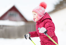Child engaged on  skiing in the winter Royalty Free Stock Image