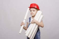 Child engineer keeps many drawings Stock Image
