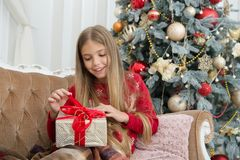 Child enjoy the holiday. Christmas tree and presents. Happy new year. Winter. xmas online shopping. Family holiday. The. Morning before Xmas. Little girl. Thank royalty free stock images
