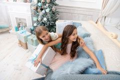 Child enjoy the holiday. Happy new year. Winter. xmas online shopping. Family holiday. Christmas tree and presents. The. Morning before Xmas. Little girls stock photography