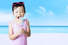 Child enjoy ice cream at seaside Royalty Free Stock Image