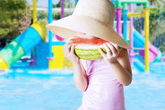 Child enjoy watermelon at pool Stock Photo
