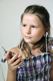 Child enjoying christian music Stock Image