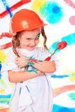 Child enjoying her painting Royalty Free Stock Images