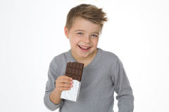 Child enjoying his favourite sweet Royalty Free Stock Photo