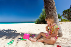 Child enjoying ice-cream on the beach Royalty Free Stock Photography