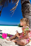 Child enjoying ice-cream on the beach Stock Photos
