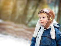 A child enjoying nature. A small pilot. A boy wearing aviator hat Royalty Free Stock Images