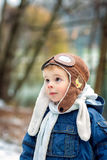A child enjoying nature. A small pilot. A boy wearing aviator hat Royalty Free Stock Photography