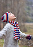 Child enjoying the snow. With closed eyes Stock Images