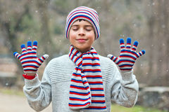 Child enjoying the snow. With closed eyes Stock Photos