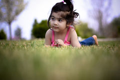 Child enjoying spring. Two year old girl enjoying spring weather Stock Image