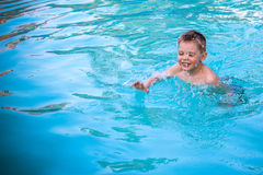 Child Enjoying Swimming in a Pool Stock Images
