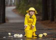 Free Child Enjoying The Rain In His Galoshes Stock Images - 145195024