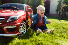 The child enjoys his toy car Royalty Free Stock Images