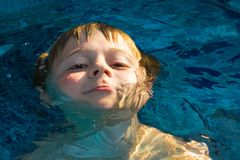 Child enjoys swimming Royalty Free Stock Images