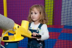 The child is entertained at the gaming center Stock Photography