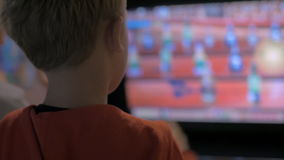 Child entertaining with arcade machine. Boy having fun playing with amusement machine. He throwing balls to the screen with moving targets and trying to hit them stock video footage