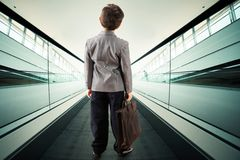 Child on escalator Stock Photos