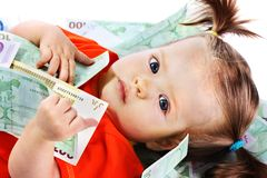 Child with euro money. Royalty Free Stock Photos