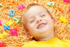 Child playing with letters beginning of the year. Royalty Free Stock Photography