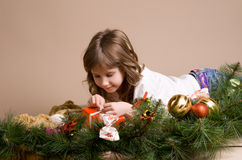 Child  on eve of Christmas. Child is lying and dreaming near tree decorations on eve of Christmas Stock Photos