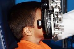 Child in examination of eyes Stock Image