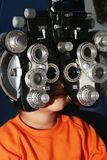 Child in examination of eyes Stock Photos