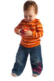 Child examining red apple, isolated Royalty Free Stock Photos