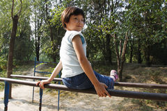 Child exercise on the parallel bars Stock Images