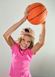 Child exercising with a ball Stock Photo