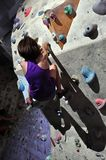 Child exercising at bouldering gym Royalty Free Stock Image