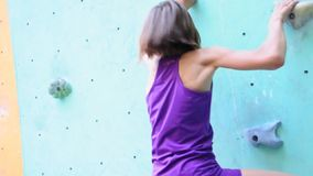 Child exercising at bouldering gym  stock footage