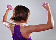 Child exercising with dumbbells Stock Photos