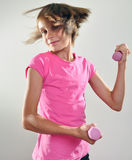 Child exercising with dumbbells Royalty Free Stock Photos