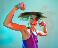 Child exercising with dumbells Royalty Free Stock Images