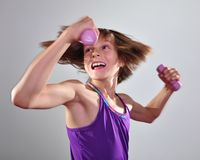 Child exercising with dumbells Royalty Free Stock Image