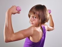 Child exercising with dumbells Stock Images