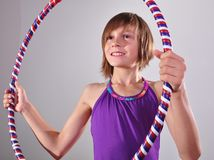 Child exercising with a hoop Stock Images