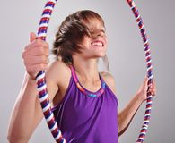 Child exercising with a hoop Royalty Free Stock Photography